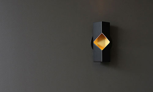 Luminaria de pared Phase para RBW. Diseño por David Rockwell
